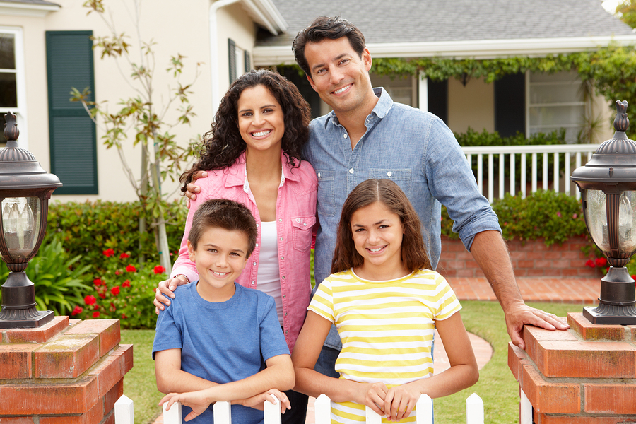 bigstock Hispanic family outside home 23443583 - FAQs